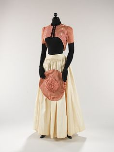 Elsa Schiaparelli (Italian, 1890–1973). Ensemble, summer 1940. The Metropolitan Museum of Art, New York. Brooklyn Museum Costume Collection at The Metropolitan Museum of Art, Gift of the Brooklyn Museum, 2009; Gift of Arturo and Paul Peralta-Ramos, 1954 (2009.300.789a–c) | This skirt references eighteenth and nineteenth-century petticoats and is effortlessly perfect for a summer holiday. The choice of red and white striped cotton for the bolero and hat is reminiscent of striped beach…