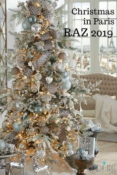2019 RAZ Christmas Tree Inspiration Too early to start thinking about Christmas inspiration? Most people like to know what's coming down the pike so they can start planning early, pick Christmas Tree With Snow, Country Christmas Trees, Elegant Christmas Trees, Christmas In Paris, Ribbon On Christmas Tree, Christmas Tree Themes, Holiday Decorations, Christmas Mantles, Christmas Villages