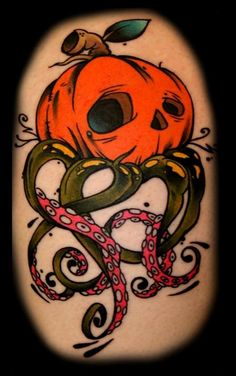 "pumpkin octopus tattoo. I really like the art style of this pumpkin.  When I get mine done, this is one that I want to take in as an example.  The shading, bright colors, and touch of ""cartoon"" art really marry well together."