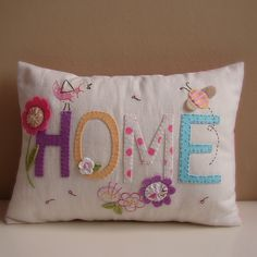 Pillow with hand-stitching and yo-yos.