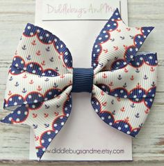 Anchor Pinwheel Bow, Girls Red and Blue Anchor Hair Bow, Hair Bow, Beach Hair Bow, Girl's Hair Bow, Pinwheel Hair Bow, Nautical Hair Bow by DiddlebugsAndMe on Etsy https://www.etsy.com/listing/263167609/anchor-pinwheel-bow-girls-red-and-blue