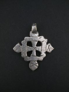 This Ethiopian Coptic Cross is made by the Christian community of Ethiopia and…