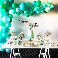 Such a beautiful colour combination 😍😍😍 #Repost @styling_stories ・・・ We had the pleasure styling this gorgeous dessert table today for little Jamie & Luke's christening/first birthday! With light shades of blues & greens and a touch of gold, it made the perfect setup for the gorgeous twin boys! 💙💙 Styling, flowers & white trestle by us @styling_stories Balloon arch @partysplendour Cake @cakesbychrissyt Lettering & Cake topper @communicakeit Desserts & cookies @petite.patisserie Macar...