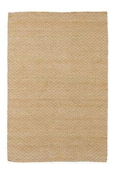 """Fint teppe med klassisk mønstret """"gåseøye"""". Varp av bomull. <br><br>100% ull<br>Rengjøres ved støvsuging"""
