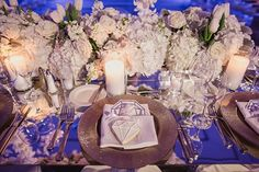 Diamonds are a guest's best friend at this wedding celebration. Details like mirrored tabletops glittery chargers and gem-shaped sugar cookies contribute to the glamorous theme.|| Venue: @fairmonthotels | Florals: @bflive | Photographer: Shaun Menary Photography | Laser Cut Décor: Artifacture Studios | Dancefloor: @dfwdancefloors | Rentals: @bellaacento | Stationery and Graphics: 5by7 Designs | Lighting/AV/Production: @leforcedj | Linens and Napkins: @nuagedesignsinc || #partyslate…