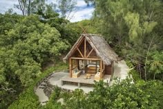 Swank, private little huts on the beach, just steps away from the beautiful blue tropical ocean surrounding the Madagascar islands.