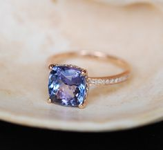 Tanzanite Ring. Rose Gold Engagement Ring Lavender Mint Tanzanite emarald cut halo engagement ring 14k rose gold. by EidelPrecious on Etsy https://www.etsy.com/listing/236522492/tanzanite-ring-rose-gold-engagement-ring