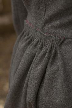Cartridge pleating on coat skirt | Indigo Orchid