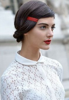 Paris fashion week  I love the dark hair and red clips, pale skin and red lips.  Love.