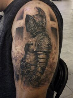 What does gladiator tattoo mean? We have gladiator tattoo ideas, designs, symbolism and we explain the meaning behind the tattoo. Gott Tattoos, Leg Tattoos, Body Art Tattoos, Sleeve Tattoos, Tatoos, Future Tattoos, Tattoos For Guys, Gladiator Tattoo, Tatoo Styles