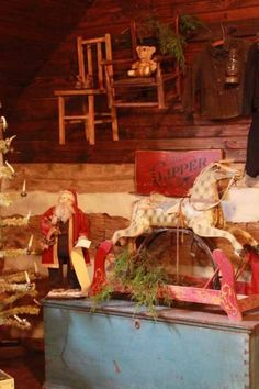 Old Cabin Christmas...Santa,wooden rocking horse & chairs on the wall with teddy & pine