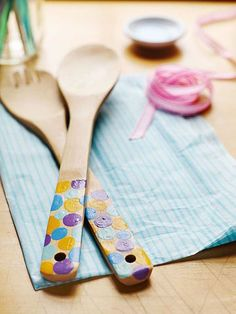Paint patterns on store- bought spoons for a present that's both useful and sentimental.                 Lightly sand the handles of a pair of wood or bamboo salad servers, then rinse and dry them. Place a ring of masking tape midway down each handle. Pour a few colors of acrylic paint onto a disposable plate. Have your child dip a finger into the paint, then make dots on the handles. Let the paint dry before adding overlapping dots. Remove the tape. After the paint is completely dry, coat…