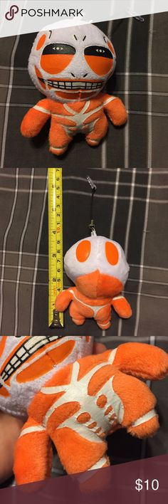 ✨Attack on Titan Colossal Cell Phone Plush Charm✨ A plush cell phone charm of Colossal Titan from AoT Attack on Titan (SnK Shingeki no Kyojin) anime! Also known as a dust plug. Plugs into any auxiliary (aux) socket like a headphone jack. Used only once to test to make sure it fits. Came with no tags attached.  Consider looking at the rest of my store, I have a 20% bundle discount and consider most good offers! Attack on Titan Accessories Phone Cases
