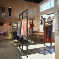 A women's athletic shop in Seattle by local firm goCstudio features a display system that can be elevated with a hand crank to make way for in-store events