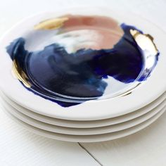 Your organic meals deserve to be plated on these handpainted porcelain dinner plates, dont you think? The dark navy pools, peachy pink strokes