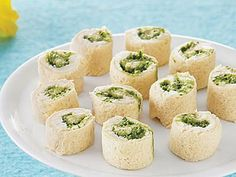 Creamy Pesto Pinwheels | Super easy finger foods are the perfect way to kick off a party. No forks or spoons are required for these easy-to-pick-up party foods, so you can clean up in no time. If you decide to throw an all-appetizer party, make sure you provide a variety of options: chips and dip, warm spreads, easy pick ups, and even one-bite salads can be combined to set out the perfect spread. You'll like these easy finger foods so much that you might even skip dessert.