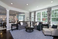 Accent curtains paired with charcoal couch. #ModelHome