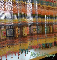 Crocheted granny squares curtain, I need to start collecting thread for this or something like it. Gorgeous.