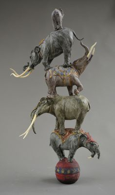 A wonderful sculpture showing various prehistoric elephants.