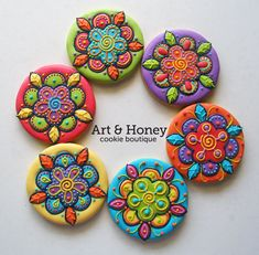Highly decorated cookies with vibrant color. Mandala and flower like.