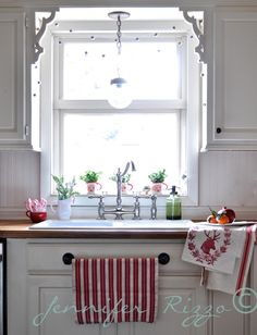 Jennife rizzo's kitchen sink area; love the pendant, open window with just corbels, the sink, and the faucet. so cute! want to do this in my kitchen.