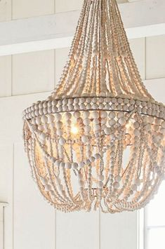 Dining room lighting: How a dining room chandelier will elevate your dining room decor Wood Bead Chandelier, Luxury Chandelier, Chandelier In Living Room, Ceiling Chandelier, Chandeliers, Pottery Barn Chandelier, Beach Chandelier, Bathroom Chandelier, Dining Room Lighting
