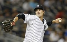 New York Yankees relief pitcher Andrew Miller winds up in the ninth inning of the Yankees 5-1 victory over the Kansas City Royals in a baseball game at Yankee Stadium in New York, Tuesday, May 26, 2015.  - (AP Photo/Kathy Willens)