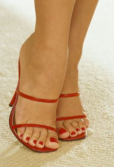Awesome feet in delicate high heels.