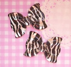 Extra cute and extra large zebra print, black & white kitsch bows. These flat back resin cabochon beads are perfect for all kinds of kawaii crafts, including decoden. #JewelryShop
