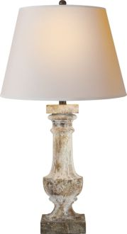 We have two of these lamps.  Their finish is done as if they had been sitting and aging out in a garden.  I affectionately call them our bird poop lamps which doesn't sound very appealing, but the layers of color are so wonderful.  They beautifully pull together our interior colors and exterior views.