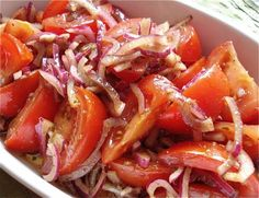 Greek Style Tomato and Onion Salad from Food.com:   A recipe given to me by my Cypriot neighbor.. its really great, with just the right amount of vinegar and olive oil... made a few hours ahead  gives the onion a bit of time to absorb the wonderful flavors