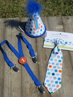 Lanes Cake Smash Baby boy / Toddler Cake Smash Birthday Outfit including a necktie suspenders & party hat in Blue Orage Gray Dot. $42.75, via Etsy.