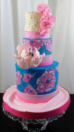 This is the smallest three tiered cake that I have done, 3inch, 4inch and 6inch finished in buttercream with fondant and edible image prints and a gumapste parrot tulip. Vanilla and chocolate cake.   This was done for a booth  at a trade show for a local Lily Pulitzer via Store The Cabana. I love this size so cute with a big cake feel.