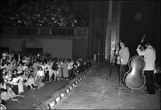 May 14, 1956: Elvis Presley plays the Twin Cities |  About 3,000 fans showed up for the Minneapolis concert. Those look like police -- actual police, not security guards -- making sure fans didn't get too close to the stage. | Elvis Presley arrived in the Twin Cities on May 13, 1956, to play two concerts: a matinee at the St. Paul Auditorium and an evening gig at the Minneapolis Auditorium.