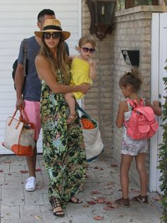 : En route to a Labor Day party in Malibu, CA, Jessica worked a printed maxi dress with a panama hat and black sandals.