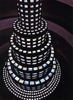 Nam June Paik|The More the Better - 1988. Three channel video installation with 1,003 monitors and steel structure; color, sound; approx. 60 ft. high.