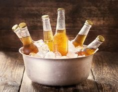 beer bottles on ice in bucket
