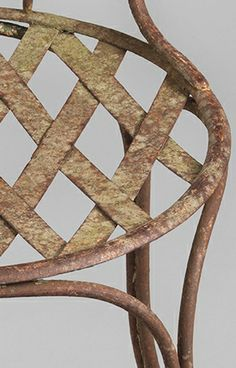 Detail of Minimal Early Metal Chair With Original lattice Work Seat, Weathered Hand Wrought Iron with Traces of Historic Paint, French, c.1880 (Available at Robert Young Antiques)