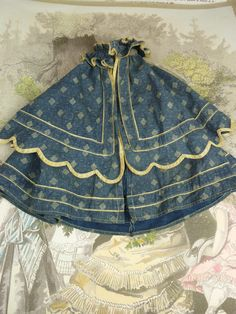 Blue patterned original French dolls cape with sleeveless undercoat from stairwaytothepast on Ruby Lane