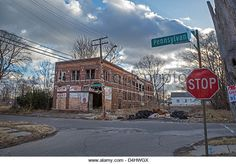 Detroit, Michigan - Abandoned buildings and vacant lots characterize Pennsylvania Avenue on Detroit's east side. - Stock Image