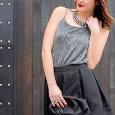 Silver shimmer camisole tank top This silver tank top can be worn tucked in or out. Great when paired with a blazer or alone to ad extra glitter to your day or evening! Amazing condition. Only worn once. Lovemarks Tops Camisoles