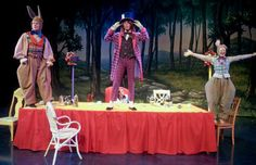 The March Hare (BraSuchy) Dormouse (Kelly Devine) Mad Hatter (Nick Rossiter) explatheir teparty Alice (MarlisBarrett) during dress rehearsal for Lake