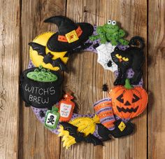 Bucilla Witch's Brew Wreath - Halloween Felt Applique Kit. Complete kit includes stamped felts, cotton floss, color separated sequins & beads, two needles, and