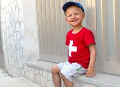 This young Swiss Fan in in love with swiss souvenirs.