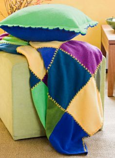 Better Homes and Gardens tutorial for pillow and throw. I really like the patchwork throw.different from the usual fringed type fleece. No Sew Fleece Blanket, No Sew Blankets, Polar Fleece Blankets, Patchwork Blanket, Quilted Pillow, Fleece Fabric, Fleece Scarf, Knitted Blankets, Baby Blankets