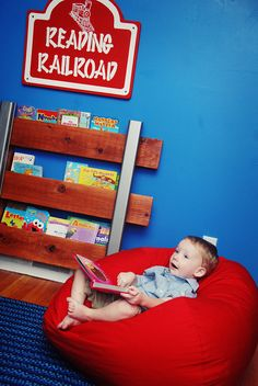Vintage Trains, Planes, & Automoblie Little Boys Room with custom-made railroad track bookshelf and sign
