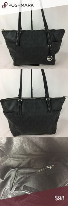 """Michael Kors Jet Set East West Top Zip Tote Black Condition: Gently Used. Light scratches on hardware and some wear on handles that is common with this model.  M1    Overall in good condition. From MK: We created a spacious, streamlined shape from our signature logo print, adding leather top handles for luxe contrast. Two exterior slit pockets. Interior Zip pocket, cell phone pocket, three interior pouch pockets, key fob. Fully lined. 14"""" x 11"""" x 5    Thank you for your interest! No Trades…"""