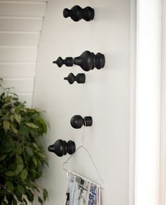 DIY Wall hooks made from curtain rod finials or finials from the wood department at Home Depot. Use as decor or to hang towels.