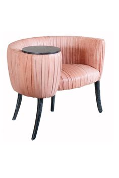 Kelly Wearstler's souffle cocktail chair mimics the spiraled style of so many dramatic Derby hats.