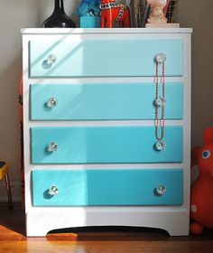 Ombre dresser. Looked so crappy before but see what wonders a new paint job can do!